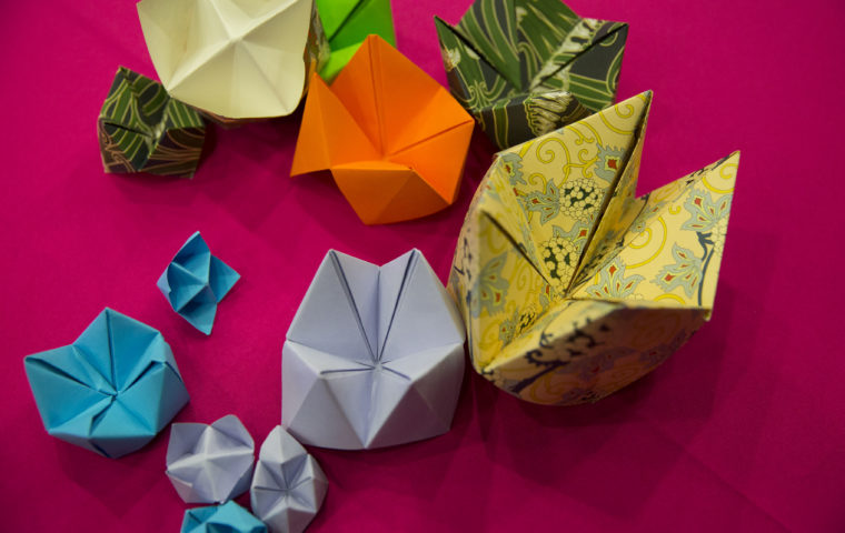 Decorum, origami decorations on pink - photo by Holly Falconer