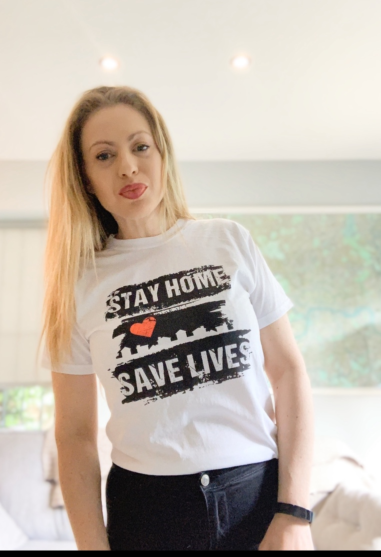 Kelly wearing white Stay Home Save lives tshirt